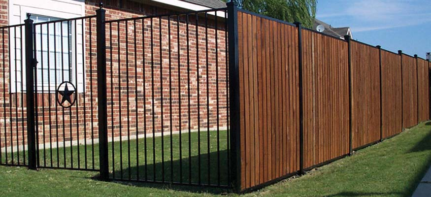 Wrought iron what you must know before you install the for Fortress fence design